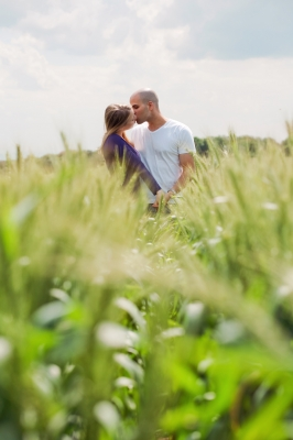 couples kissing in a green field